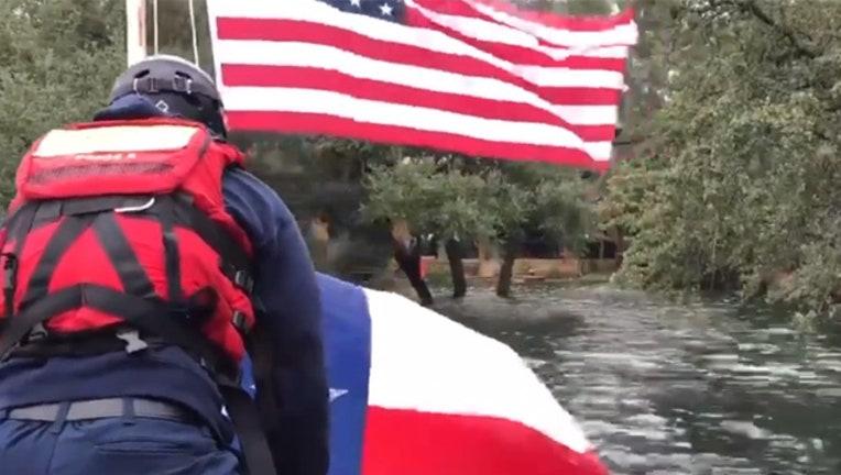 ef969ddf-KTBC flag recue flood 10182018_1539895747852.jpg-407693.jpg