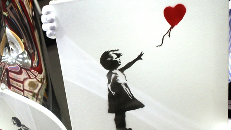 f5304def-GETTY Banksy Girl with Red Balloon
