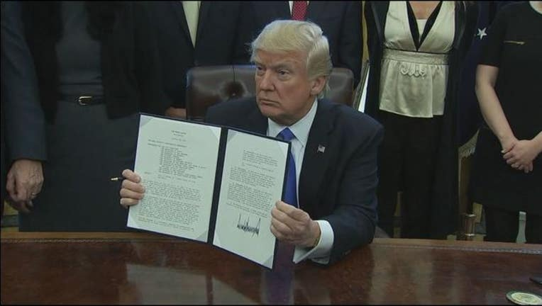 f8a58266-President Trump signs an executive order giving the Joint Chiefs 30 days to come up with a plan to defeat ISIS.