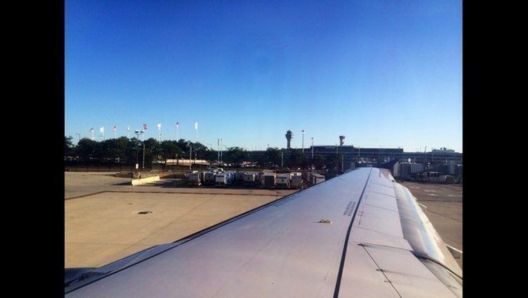 f8a788cb-ohare-airport-airplane-wing