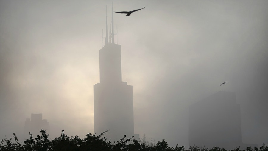 Heavy fog limits visibility to a quarter mile, prompting more than 100 flight cancellations