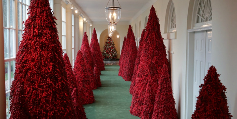 White House Christmas Ornament 2019.Melania Trump S Red Topiary Trees Popular At White House