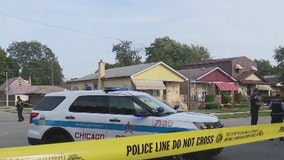 Woman critically hurt inside Englewood home by stray bullet after man shot outside
