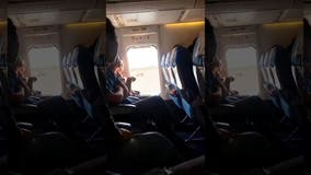 Plane passenger opens emergency exit for 'a breath of fresh air'