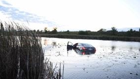 Woman escapes vehicle after it plunges into Aurora retention pond