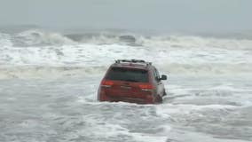 Driver abandons Jeep in waves after getting stuck on South Carolina beach during Hurricane Dorian