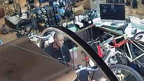 New video shows suspect in bike repair shop not long before woman was shot in the back