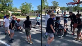 Kids cheer on classmate in wheelchair, help him score during basketball game