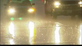 Six killed when pounding rain sweeps cars off Indiana road