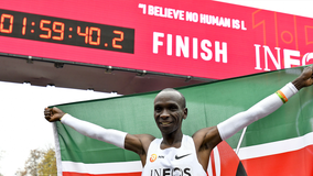 Kenya's Eliud Kipchoge becomes first person to shatter 2-hour marathon barrier