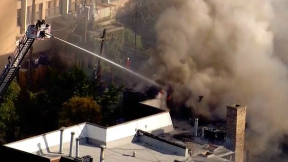 Firefighters battle blaze at Uptown apartment building