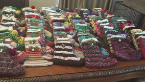 Volunteers in suburban Chicago stuff holiday stockings for soldiers