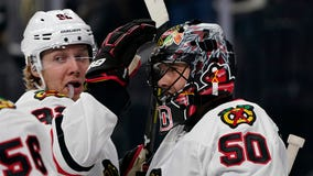 Crawford, Blackhawks win 5-3 for 1st victory over Las Vegas