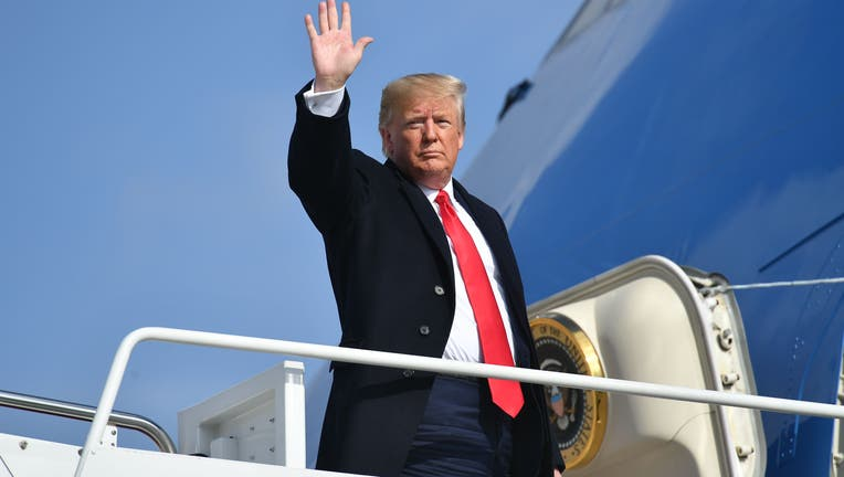 US President Donald Trump makes his way to board Air Force One before departing from Andrews Air Force Base in Maryland on November 20, 2019. - President Trump is heading to Austin to tour an Apple computer manufacturing facility. (Photo by MANDEL NGAN / AFP) (Photo by MANDEL NGAN/AFP via Getty Images)
