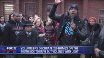Volunteers decorate 250 homes on South Side to drive out violence with light