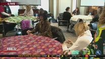 Volunteers making blankets for kids in need