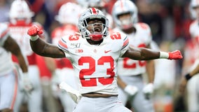 Ohio State claims Big Ten title with win over Wisconsin 34-21
