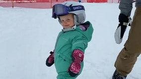 Baby shreds snow on Utah ski slopes