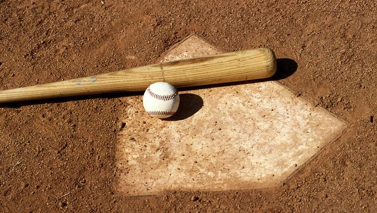 GETTY Stock image of baseball, baseball bat and home plate