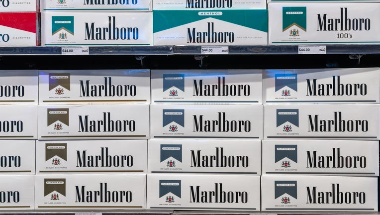 ORLANDO, FLORIDA, UNITED STATES - 2019/07/19: Pattern form by the word 'Marlboro' which is seen in boxes of cigarettes exhibited in a store shelf. Marlboro is an American brand of cigarettes, currently owned and manufactured by Philip Morris USA. (Photo by Roberto Machado Noa/LightRocket via Getty Images)