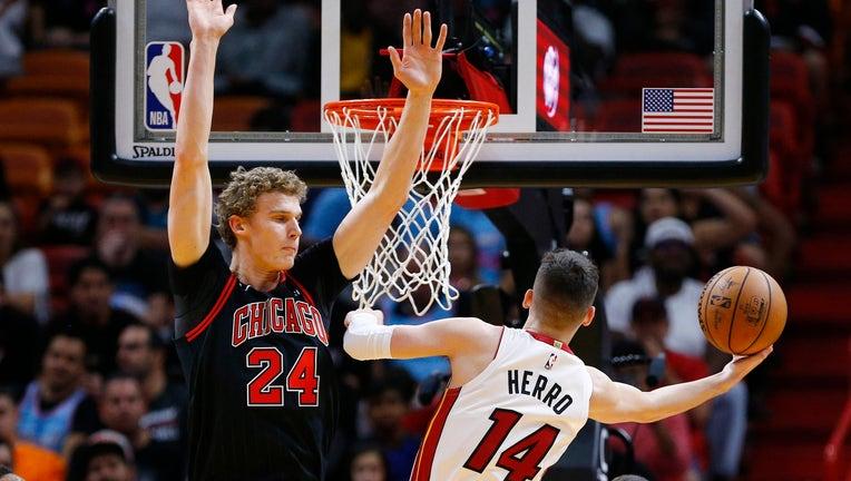 Bulls player Lauri Markkanen faces Tyler Herro of the Miami Heat