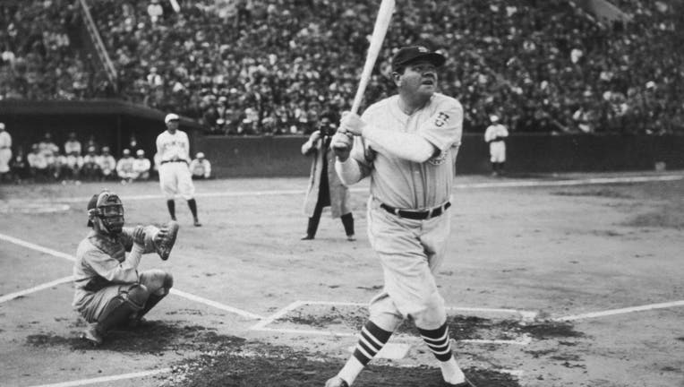 1934: American baseball player Babe Ruth (George Herman Ruth, 1895 - 1948) hits his first home run during his tour of Japan at Miji Shrine Stadium, Tokyo, Japan. (Photo by New York Times Co./Getty Images)