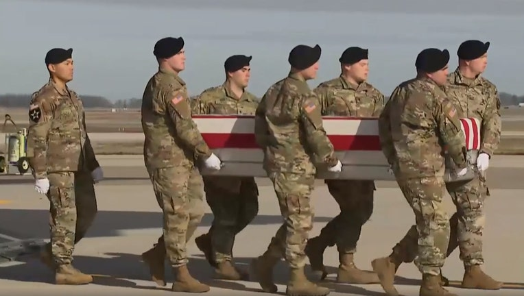 U.S. service members carry a casket containing the remains of Sgt. 1st Class Michael J. Goble from a transport plane to a van at Dover Air Force Base in Delaware, Dec. 25, 2019.