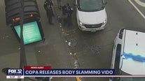 Video appears to show cop picking up unconscious man by pants/underwear after he was body slammed