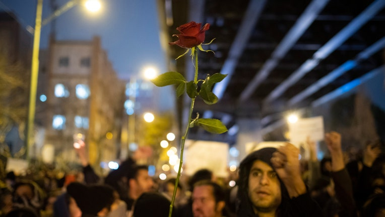 An Iranian protester (Not pictured) holds-up a flower as she attends in front of a University to mark the memory of the victims of the Ukraine Boeing 737 passenger plane in Tehrans business district on January 11, 2020. Irans Revolutionary Guard Corps (IRGC) said on January 11th that they have shut down the Ukrainian passenger plain during a wrong attach as they were ready for the U.S. possible missile attack against the 52 targets in Iran. (Photo by Morteza Nikoubazl/NurPhoto via Getty Images)