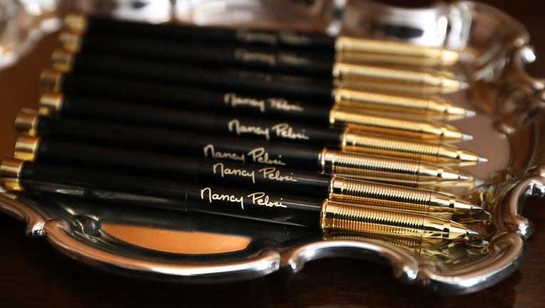 Pens with U.S. Speaker of the House Nancy Pelosi's (D-CA) signature are prepared for the engrossment ceremony of the articles of impeachment against President Donald Trump in the Rayburn Room at the U.S. Capitol