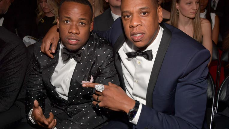 LOS ANGELES, CA - FEBRUARY 12: Hip Hop Artists Yo Gotti and Jay-Z during The 59th GRAMMY Awards at STAPLES Center on February 12, 2017 in Los Angeles, California. (Photo by Lester Cohen/Getty Images for NARAS)