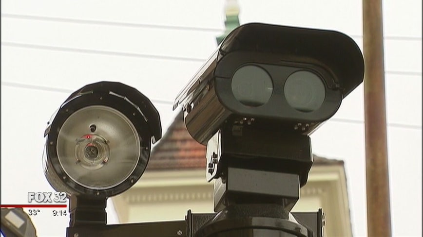 Illinois House OKs partial red-light camera ban, part of fed probe