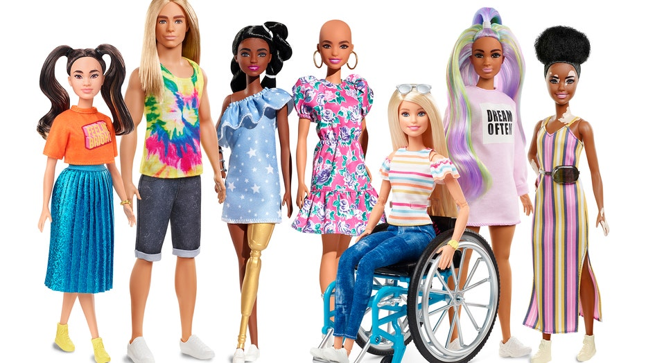 New dolls in Barbie's 2020 Fashionistas lineup include a Ken doll with long, rooted hair, a doll with darker skin and a gold prosthetic limb, a doll with no hair and a doll with the skin condition vitiligo. (Photo credit: Mattel)