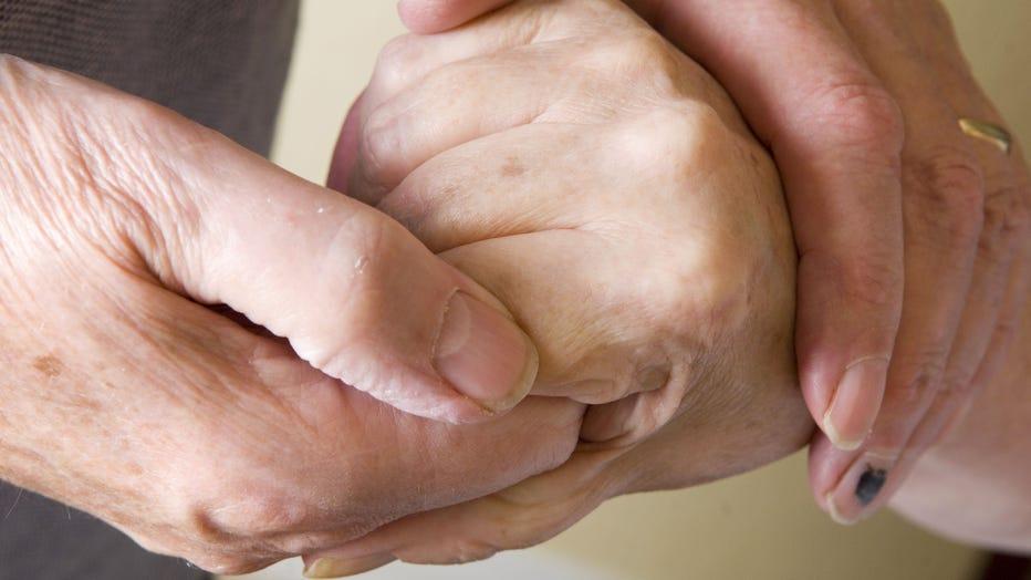 holidng-hands-GETTY.jpg