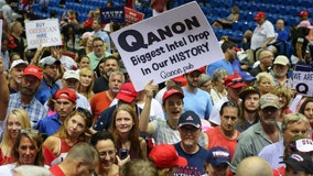 QAnon supporters sharing 'deep state' satanic sex trafficking ring/cannibalism theories at Trump rallies