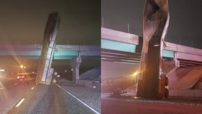 Dump truck traveling with trailer upright crashes into Indiana overpass