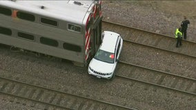 2 taken to hospital after Metra UP-NW train hits vehicle in Arlington Heights