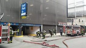 1 taken to hospital after car fire in River North parking garage