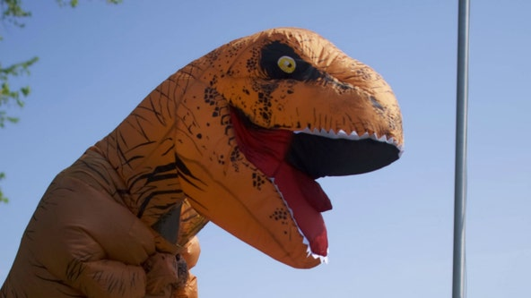 Cops called to pot smell coming from neighbor's apartment find burning T-Rex costume instead