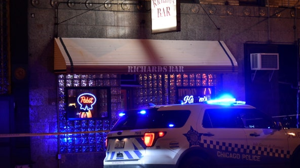 Man fatally stabbed outside West Town bar, suspect arrested