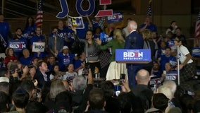 Women holding 'let dairy die' signs storm stage at Biden Super Tuesday event