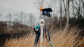 Student dons cap and gown over mask, protective suit in coronavirus-altered graduation photos