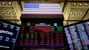 Dow rises as S&P, Nasdaq slip in volatile session