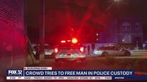 Crowd tries to free man arrested while police break up repast, 5 in custody