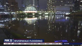 Day of rain leaves Chicago River surging, roads flooding