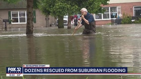 Dozens rescued from suburban flooding after record-setting rainfall