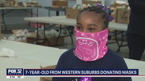 7-year-old suburban girl donating masks to anyone she can