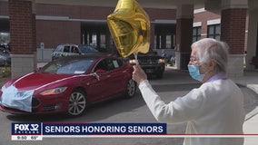 Suburban high school seniors honor elderly seniors in parades by nursing homes