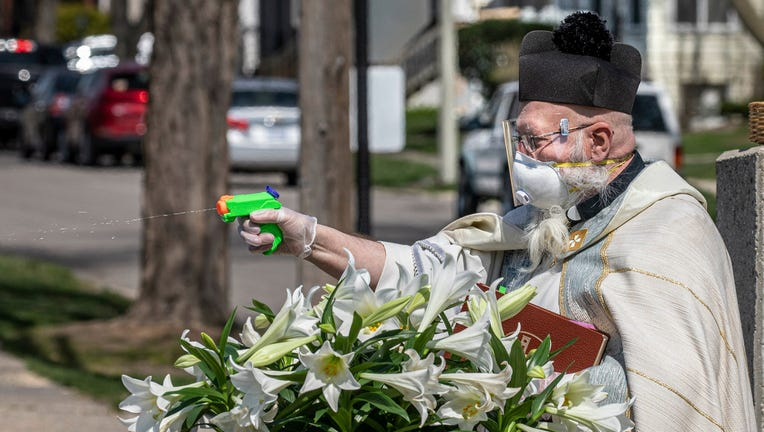 Priest Uses Squirt Gun To Shoot Holy Water And Maintain Social
