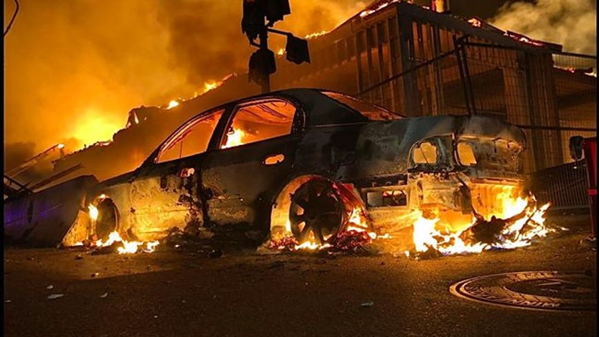 Fires set, businesses looted and 1 man killed as George Floyd protests turn violent in Minneapolis